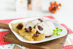 Pork chops stuffed with cranberries and garlic in onion sauce Stock Photos