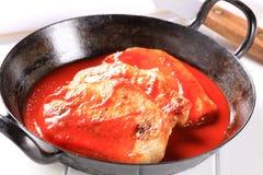 Pork chops in tomato sauce Stock Photo