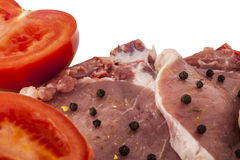 Pork chops and tomatoes closeup isolated Royalty Free Stock Photography