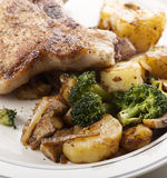 Pork chops with vegetables Royalty Free Stock Images