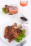 Pork chops and wine royalty free stock image
