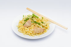 Pork chow mein with chopsticks. In white plate stock photo