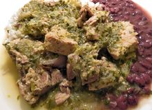 Pork Chunks in Tomatillo Salsa With Rice and Beans stock photography