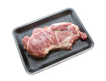 Pork collar in foam tray on white background Royalty Free Stock Images