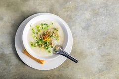 Pork Congee on the concrete table. royalty free stock photography