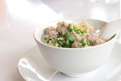 Pork congee and fried garlic Royalty Free Stock Images