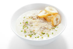 Pork congee with slice deep fried doughstick. Close up Royalty Free Stock Photo