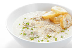 Pork congee with slice deep fried doughstick royalty free stock photo