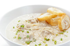Pork congee with slice deep fried doughstick stock image