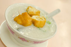 Pork Congee soup with deep fried breads to eat Royalty Free Stock Photo