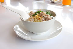 Pork congee spoon and fried garlic Royalty Free Stock Photography