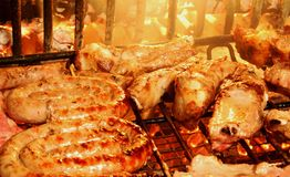 Pork cooked on the grill in the glowing embers of the fireplace. Pork cooked on the barbecue of the fireplace stock photo