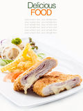 Pork cordon bleu with french fries. Royalty Free Stock Images