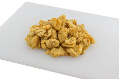 Pork Cracklin on cutting board Royalty Free Stock Image