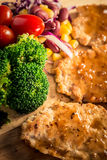 Pork cube steak topped with pepper sauce. And creamy salad on wood plate stock images