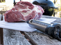 Pork cutlet injecting with food syringe Royalty Free Stock Photos