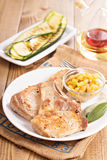 Pork cutlets on a bone with apple chutney Stock Images