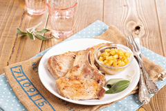 Pork cutlets on a bone with apple chutney Royalty Free Stock Images