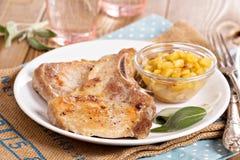 Pork cutlets on a bone with apple chutney Royalty Free Stock Photos