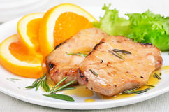 Pork cutlets with orange sauce Royalty Free Stock Image