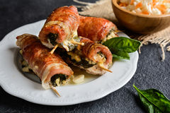 Pork cutlets wrapped in bacon and stuffed with cheese, spinach and sun dried tomato Stock Photos