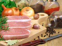 Pork on a cutting board Royalty Free Stock Photo
