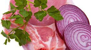 Pork on an edge. With an onions and greens Royalty Free Stock Images
