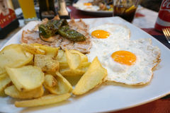 Pork with eggplants and fried eggs Royalty Free Stock Photography