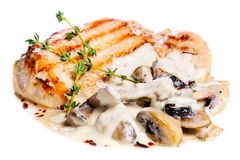 Pork escalope with mushrooms. Light grilled pork escalope with mushrooms in white sauce and rosemary Royalty Free Stock Photography