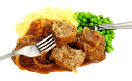 Pork Meal. With mashed potatoes and peas isolated on a white background royalty free stock photo