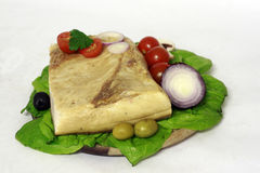 Pork fat. On decorative salad with vegetables Stock Photo