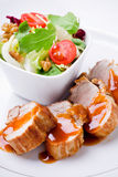 Pork Filet With Salad Stock Photography