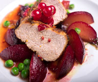Pork fillet with apples, frozen peas and red currant Royalty Free Stock Images