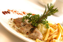 Pork fillet with chanterelle sauce Royalty Free Stock Photo
