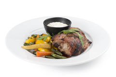 Pork fillet with grilled vegetables. Pork fillet with grilled Sousse, pepper, carrots, beans and corn Royalty Free Stock Photos