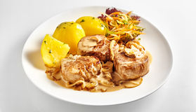 Pork fillet pieces with potatoes stock photo