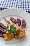 Pork Fillet. Pork sirloin garnished with apples cooked in wine, mustard and parsley Stock Photo