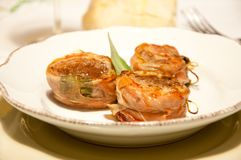 Pork fillet wrapped in speck with sage. Italy Stock Photos