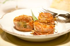 Pork fillet wrapped in speck with sage. Italy Royalty Free Stock Photography