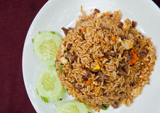 Pork Fried Rice. With cucumber garnish in Asia Stock Photo
