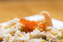 Pork fried rice with crab roe Stock Image