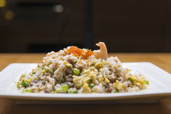 Pork fried rice with crab roe Stock Photo