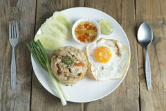 Pork fried rice and fried egg with vegetable. Stock Photography