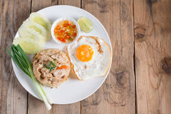 Pork fried rice and fried egg with vegetable. Top view. Royalty Free Stock Images