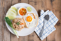 Pork fried rice and fried egg with vegetable. Top view. Stock Images