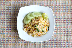 Pork fried rice serving with lime and cucumber Royalty Free Stock Images