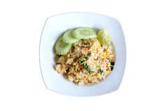 Pork fried rice serving with lime and cucumber Stock Photo