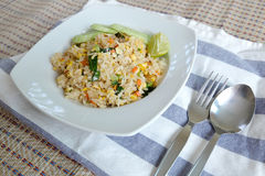 Pork fried rice serving with lime and cucumber Royalty Free Stock Image