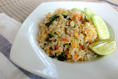 Pork fried rice serving with lime and cucumber Royalty Free Stock Photography