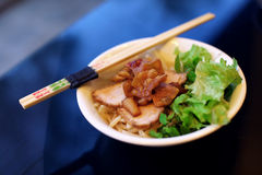 Pork fried and sliced on salad and rice noodles Stock Images